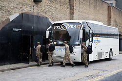 © Licensed to London News Pictures. 20/07/2012. London, UK. Members of the British military arrive by coach at Tobacco Dock in East London. The base will accommodate 2,500 soldiers during the London 2012 Olympic Games.. Photo credit : Vickie Flores/LNP