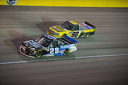 March 1, 2019 - Las Vegas, Nevada, U.S. - LAS VEGAS, NV - MARCH 01: Spencer Boyd (20) Randy Young Chevrolet Silverado (bottom) and Grant Enfinger (98) Curb Motorsports Ford F-150 during the NASCAR Gander Outdoors Truck Series The Strat 200 on March 01, 2019, at the Las Vegas Motor Speedway in Las Vegas, Nevada (Photo by Matthew Bolt/Icon Sportswire) (Credit Image: © Matthew Bolt/Icon SMI via ZUMA Press)