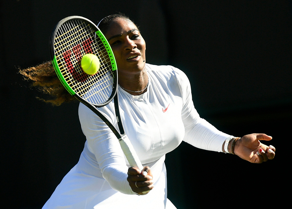 Serena Williams of the US returns to Arantxa Rus of the Netherlands in their first round match during the Wimbledon Championships at the All England Lawn Tennis Club, in London, Britain, 02 July 2018. EPA-EFE/NEIL HALL