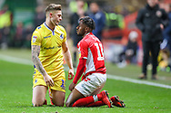 Bristol Rovers defender James Clarke (15) has words with Charlton Athletic midfielder Tariqe Fosu (11) after a tackle during the EFL Sky Bet League 1 match between Charlton Athletic and Bristol Rovers at The Valley, London, England on 24 November 2018.
