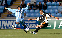 Photo: Henry Browne.<br /> Coventry City v Hull City. Coca Cola Championship.<br /> 24/09/2005.<br /> Andy Impey of Coventry tries to intercept a pass from Hull's Craig Fagan.