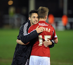 Bristol City's goalscorer Sam Baldock celebrates the win with Bristol City's Joe Bryan - Photo mandatory by-line: Dougie Allward/JMP - Mobile: 07966 386802 11/03/2014 - SPORT - FOOTBALL - Peterborough - London Road Stadium - Peterborough United v Bristol City - Sky Bet League One