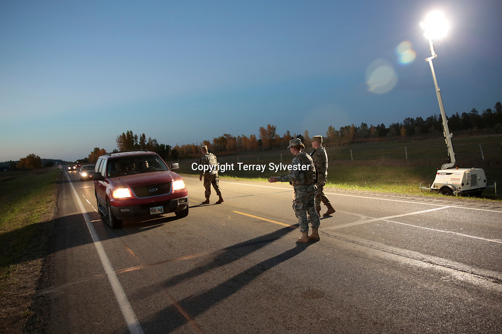 National Guard soldiers man a checkpoint on State Highway 1806 north of the Dakota Access oil pipeline route on October 1, 2016. North Dakota, United States.
