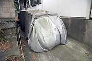 car with protective cover in driveway