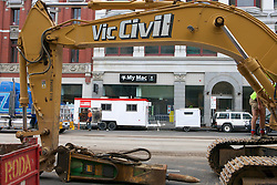 Construction Equipment with Mac Store Across the Street