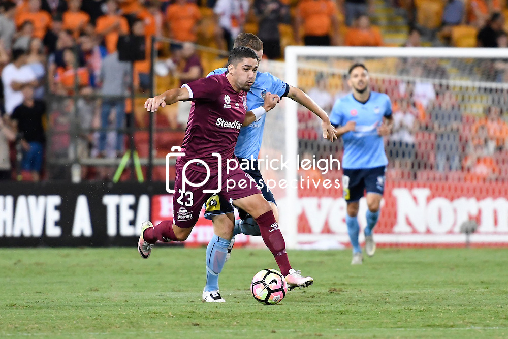 BRISBANE, AUSTRALIA - FEBRUARY 3: Dimitri Petratos of the Roar dribbles the ball under pressure from Brandon O'Neill of Sydney during the round 18 Hyundai A-League match between the Brisbane Roar and Sydney FC at Suncorp Stadium on February 3, 2017 in Brisbane, Australia. (Photo by Patrick Kearney/Brisbane Roar)