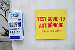 Rapid Covid antigen testing sign outside pharmacy next to Durex machine, Southern France 2021