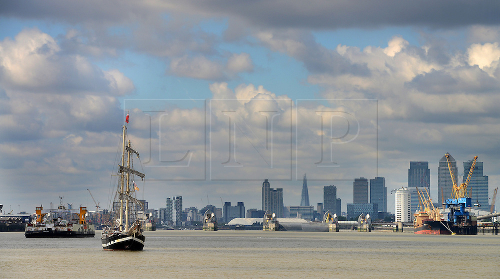 © Licensed to London News Pictures. 30/08/2013. London, UK. Tall Ships on The Thames at Greenwich, with The Cutty Sark in view,  marking one year until The Tall Ship Regatta, Falmouth to Greenwich in August 2014. Here Tall Ship Lady of Avenel is seen with The Woolwich Ferry and Canary Wharf in the distance. Photo credit: Mike King/LNP