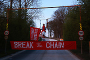 Anti-fracking climate activists from Reclaim the Power blocking a gate to Leapers Wood quarry, March 27th 2017 near Lancaster, United Kingdom. The quarry is owned by Tarmac, a crh pompany which supposedly is supplying aggregates to the building of fracking sites in Lancashire.  The blockad, done by one woman in a swing, is causing huge disruption and is part of the groups targeting of companies supplying to the fracking industry. The blockade is the first of an announced run of direct actions called Break the Chain, tageting the supply chain of the fracking industry.