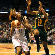 Kelsey Bone, (left), Connecticut Sun, drives to the basket defended by Tanisha Wright, Seattle Storm, during the Connecticut Sun Vs Seattle Storm WNBA regular season game at Mohegan Sun Arena, Uncasville, Connecticut, USA. 23rd May 2014. Photo Tim Clayton