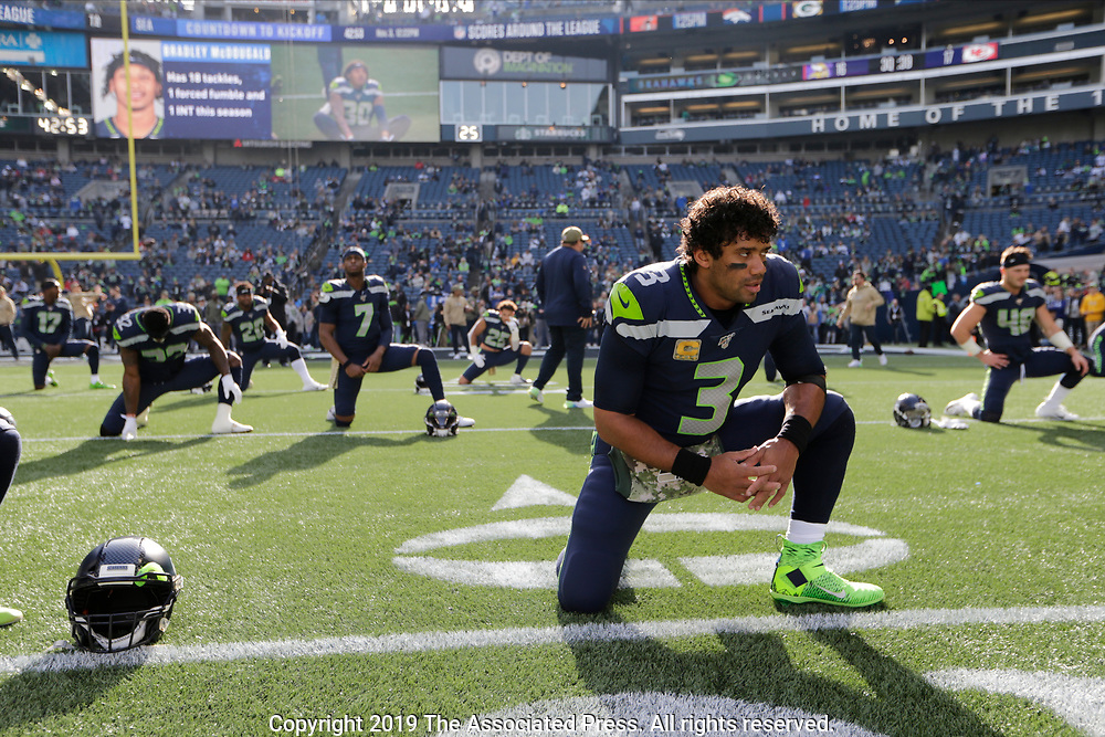 Seattle Seahawks quarterback Russell Wilson stretches before an NFL football game against the Tampa Bay Buccaneers, Sunday, Nov. 3, 2019, in Seattle. (AP Photo/John Froschauer)