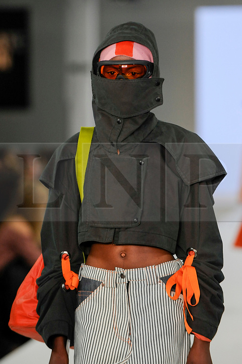 © Licensed to London News Pictures. 05/06/2017. London, UK. A model presents a look by Eyrun Muller from The Arts University Bournemouth on the second day of Graduate Fashion Week taking place at the Old Truman Brewery in East London.  The event showcases the graduation show of up and coming fashion designers from UK and international universities. Photo credit : Stephen Chung/LNP