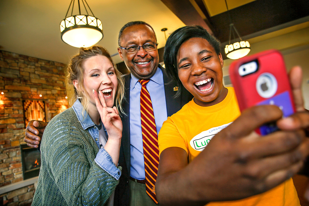 Dr. George E Ross meets with students in the RFOC dining area before and after filming an admission orientation video.  Photo by Steve Jessmore/ Central Michigan University