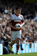 Fulham's John Arne Riise in action. Barclays premier league match ,Tottenham Hotspur v Fulham at White Hart Lane in Tottenham, London  on Saturday 19th April 2014.<br /> pic by John Patrick Fletcher, Andrew Orchard sports photography.
