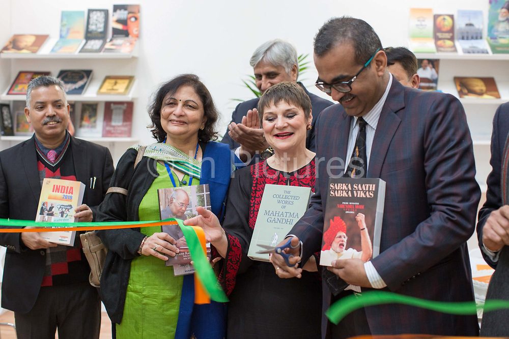 Jacks Thomas, director of the London Book Fair, with members of the Indian High Commission during day one of the London Book Fair at Kensington Olympia on the 12th March 2019 in London in the United Kingdom. Ribbon cutting to open the Government of Indias book stand.