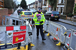 © Licensed to London News Pictures. 07/01/2016<br />  Police officer laying flowers for a local resident at the home of Sian.<br /> <br /> Ex-Eastenders actress Sian Blake's home in Erith,Kent has turned into a crime scene (07.01.2016) with officers from the Met's Homicide and Major Crime Command leading the murder investigation.<br /> <br /> (Byline:Grant Falvey/LNP)