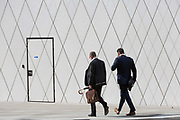 Businessmen with geometric angles and diagonal lines on new architecture at Southwark SE1, on 7th September 2018, in London, England.