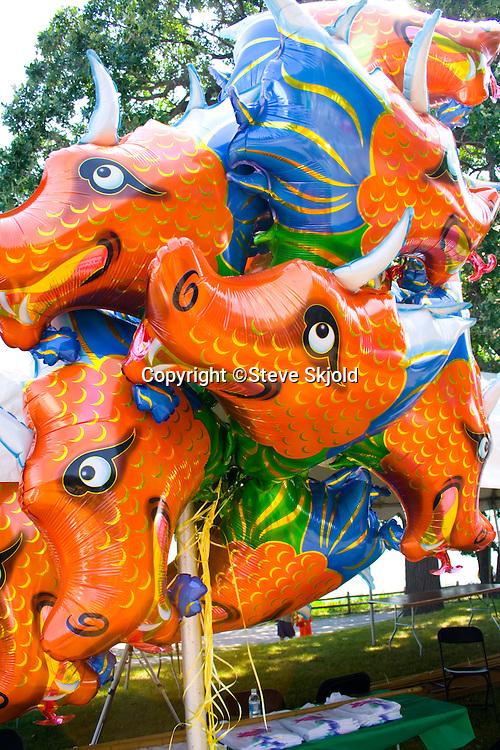 Bunch of large horned dragon balloons. Dragon Festival Lake Phalen Park St Paul Minnesota USA
