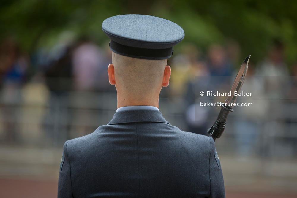On the 100th anniversary of the Royal Air Force (RAF) and before an historic flypast of 100 aircraft formations representing Britain's air defence history which flew over central London, a guard of the RAF regiment lines the Mall, on 10th July 2018, in London, England.