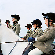 The Hawkins family from Warren Farm, (Andrew, Trudy, Giles, Hannah and Rebecca) following the Devon and Somerset stag hunt on horseback. Exmoor, Somerset, UK. Stag hunting is an activity involving the tracking, chase and sometimes killing of a stag by trained hounds and a group of followers lead by a 'master' who follow the hounds on foot or on horseback. This controversial sport, was banned in England and Wales in November 2004.