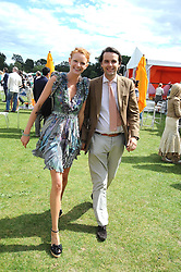 OLIVIA INGE and CHARLIE GILKES at the 2008 Veuve Clicquot Gold Cup polo final at Cowdray Park Polo Club, Midhurst, West Sussex on 20th July 2008.<br /> <br /> NON EXCLUSIVE - WORLD RIGHTS