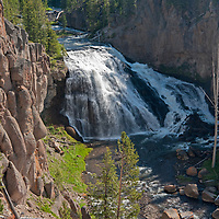 The Gibbon River pours over Gibbon Falls in Yellowstone National Park, Wyoming.