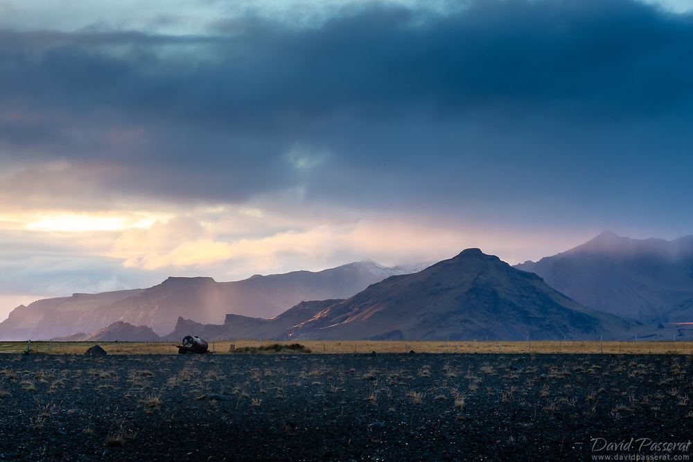 Mountain range in Iceland with approaching rain.
