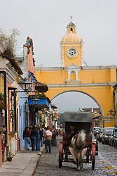 Horse drawn cart near Arch of Santa Catalina, built to allow nuns to cross street from convent to convent, Antigua, Guatemala