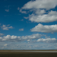 Clouds drift across the windy pampas near Puerto Natales, Chile.