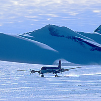 ANTARCTICA. Adventure Network DC-4 takes off from bare ice glacier, Patriot Hills, Ellsworth Mountains.  This was first private aviation company to ferry expeditions to the interior of Antarctica.
