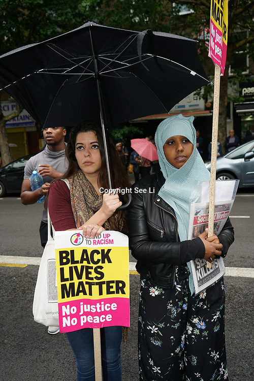 Stoke Newington Police, London, England, UK. 29th July 2017. Stand Up To Racism hosts a Justice For Rashan and Edson Da Costa protest & vigil at the front of Stoke Newington Police.