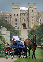 © Licensed to London News Pictures. 08/05/2018. Windsor, UK. A participant in The Royal Windsor Horse Show exercises on The Long Walk at Windsor Castle ahead of the Royal Wedding of Prince Harry and Meghan Markle. With 12 days to go there is lots of activity in and around the grounds of Windsor Castle. Photo credit: Peter Macdiarmid/LNP