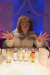 "© Licensed to London News Pictures. 19/11/2013. London, England. Pictured: Nicky Goldie as ""Fairy Goodmother"" at Penhaligon's. ""Once Upon A Christmas""  is a promenade show from the Look Left Look Right theatre company set around Covent Garden's shops, bars and restaurants with the characters on a mission to save Christmas. Photo credit: Bettina Strenske/LNP"
