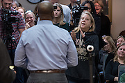 A women expresses her concern over health care with U.S. Sen. Tim Scott during a town hall meeting February 18, 2017 in Mount Pleasant, South Carolina. Hundreds of concerned residents turned up for the meeting to address their opposition to President Donald Trump during a vocal meeting held by U.S. Rep. Mark Sanford and Senator Tim Scott.