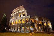 The Roman Coliseum at night, Rome, Lazio, Italy.