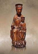 Gothic wood statue of the Virgin Mary and Child. Polychrome wood carving with varnished metal-plating. Date - First quarter of the 13th century. National Museum of Catalan Art, Barcelona, Spain inv no: 3924 .<br /> <br /> If you prefer you can also buy from our ALAMY PHOTO LIBRARY  Collection visit : https://www.alamy.com/portfolio/paul-williams-funkystock/gothic-art-antiquities.html  Type -     MANAC    - into the LOWER SEARCH WITHIN GALLERY box. Refine search by adding background colour, place, museum etc<br /> <br /> Visit our MEDIEVAL GOTHIC ART PHOTO COLLECTIONS for more   photos  to download or buy as prints https://funkystock.photoshelter.com/gallery-collection/Medieval-Gothic-Art-Antiquities-Historic-Sites-Pictures-Images-of/C0000gZ8POl_DCqE