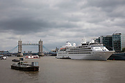 Cruise liner Silver Wind moored alongside HMS Belfast on the River Thames in London, England, United Kingdom.