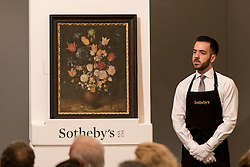 "© Licensed to London News Pictures. 06/07/2016. London, UK.  ""Still life of flowers in a stoneware vase"" by Jan Brueghel the Elder, which sold for a hammer price of GBP 3.8m (est. 3-5m at Sotheby's Old Masters evening sale in New Bond Street. Photo credit : Stephen Chung/LNP"