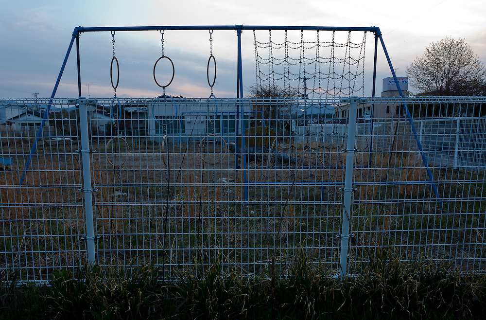 An abandoned playground in the town of Tomioka, Futaba District of Fukushima, Japan. Monday April 29th 2013. The town was evacuated on March 12th after the March 11th 2011 earthquake and tsunami cause meltdowns at the nearby Fukushima Daichi nuclear power station. It lies well within the 20 kms exclusion zone though parts of the town have recently been opened again to allow locals to visit their property during daylight hours.