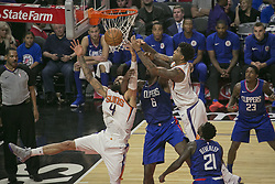 October 21, 2017 - Los Angeles, California, U.S - DeAndre Jordan #6 of the Los Angeles Clippers and Eric Bledsoe #2 and Tyson Chandler #4 of the Phoenix Suns during their regular season game on Saturday October 21, 2017 at the Staples Center in Los Angeles, California. Clippers defeat Suns, 130-88. (Credit Image: © Prensa Internacional via ZUMA Wire)