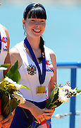 Seville. Andalusia. SPAIN. The RUS W8+ on the awards dock, Bronze Medalist Women's eights cox Ksenia VOLKOVA, at the  2013 FISA European Rowing Championship.  Guadalquivir River.  Sunday   02/06/2013  [Mandatory Credit. Peter Spurrier/Intersport]