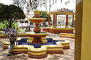 A girl sits on the edge of a fountain in a park in the town of Valle de Angeles, Honduras on Friday April 26, 2013.