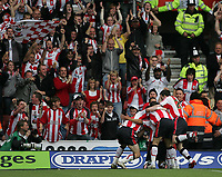 Photo: Lee Earle.<br /> Southampton v Derby County. Coca Cola Championship. Play Off Semi Final, 1st Leg. 12/05/2007.The Southampton players celebrate in front of the fans after Andrew Surman scored their first goal.