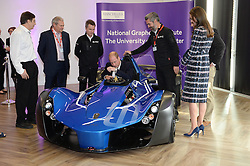The Duke of Cambridge sits in a BAC car worth £180,000 as the Duchess of Cambridge looks on at the National Graphene Research Institute during a day of engagements in Manchester.