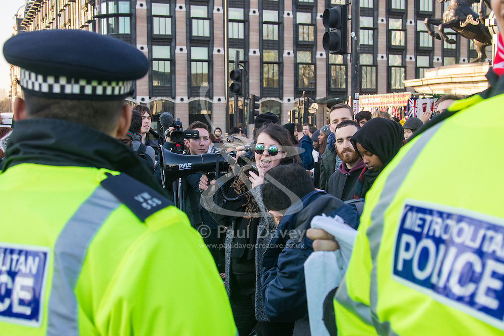 """Westminster, London, January 19th 2016. Students hold an """"emergency protest"""" in Parliament Square and later blocking Westminster Bridge, against the cutting of maintenance grants. """"It took just 18 MPs 90 minutes to scrap maintenance grants for the million poorest students, without a debate in Parliament in a backroom committee"""" PICTURED: Police keep watch as protesters block Westminster Bridge. ///FOR LICENCING CONTACT: paul@pauldaveycreative.co.uk TEL:+44 (0) 7966 016 296 or +44 (0) 20 8969 6875. ©2015 Paul R Davey. All rights reserved."""
