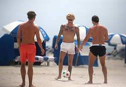 EXCLUSIVE: Liverpool keeper Loris Karius plays football with friends on the beach in Miami. 21 Mar 2018 Pictured: Loris Karius. Photo credit: MEGA TheMegaAgency.com +1 888 505 6342