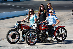 Gloria Struck on Steve Coe's flathead racer with daughter Lori DiSilva (on another one of Steve's bikes), grand-daughter Cathy and good friend Cris Simmons on the New Smyrna Speedway after the Sons of Speed Race during Daytona Bike Week. New Smyrna Beach, FL. USA. Saturday March 17, 2018. Photography ©2018 Michael Lichter.