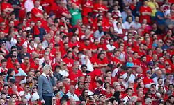 Arsenal manager Arsene Wenger looks on from the touchline