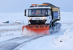 © Licensed to London News Pictures. <br /> 12/12/2014. <br /> <br /> Swaledale, United Kingdom<br /> <br /> A snow plough clears roads on the Yorkshire and Cumbrian border after overnight snow as the winter weather continues.<br /> <br /> <br /> Photo credit : Ian Forsyth/LNP
