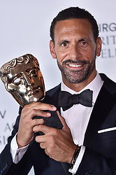 Rio Ferdinand holding his BAFTA Award at the Virgin TV British Academy Television Awards 2018 held at the Royal Festival Hall, Southbank Centre, London.